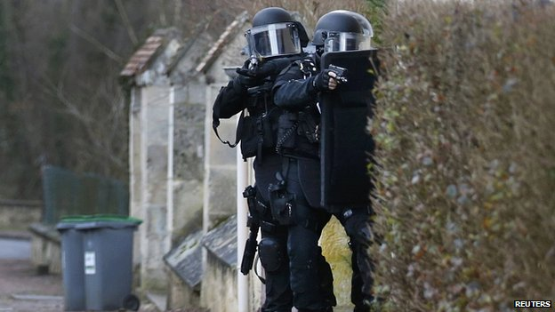 Police patrol during manhunt for suspects in attack at Charlie Hebdo in Longpont. 8 Jan 2015