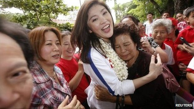 Yingluck Shinawatra with supporters at Doi Suthep temple in Chiang Mai Thailand May 21, 2011