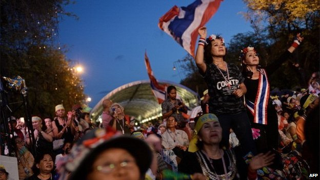 Thai anti-government protesters celebrate at their camp outside Government House after Thailand's army chief announced that the armed forces were seizing power, in Bangkok on May 22, 2014