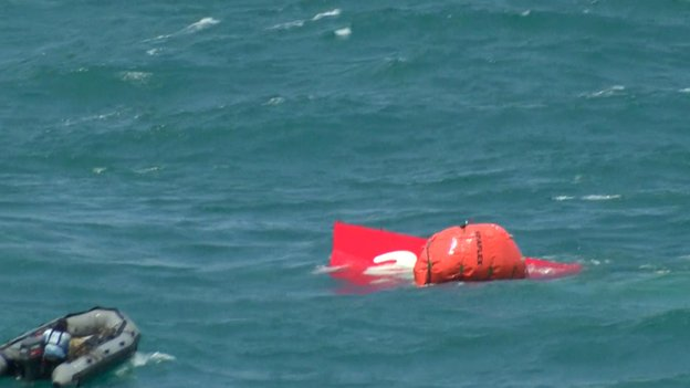 Screen grab of the Indonesian navy's operation to retrieve the tail of the Air Asia plane