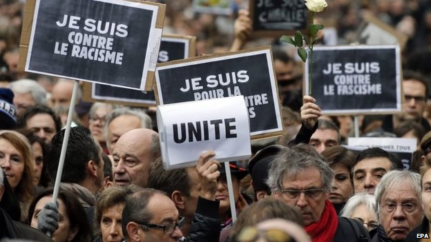 Thousands walk during a tribute to the victims of the Paris attacks in Toulouse, Southern France, 10 January 2014