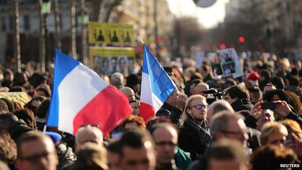 Demonstrators gather in Place de la Republique prior to a mass unity rally to be held in Paris following the recent terrorist attacks on 11 January 2015 in Paris