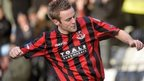 Richard Clarke celebrates scoring the opening goal for Crusaders against north Belfast neighbours Newington at Seaview