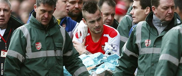 Arsenal defender Mathieu Debuchy carried off with an injury