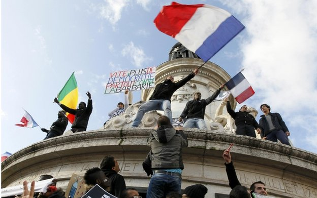 People take part in a solidarity march in Place de la Republique 2015
