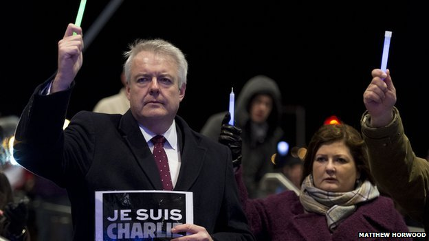 Carwyn Jones hands up a candle
