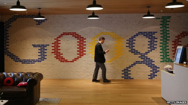 Google employee in front of mosaic