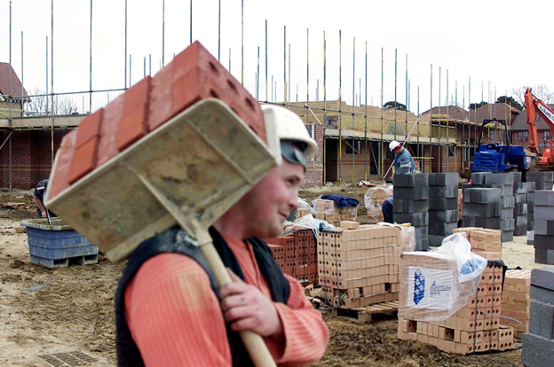 Builder on site carrying hod