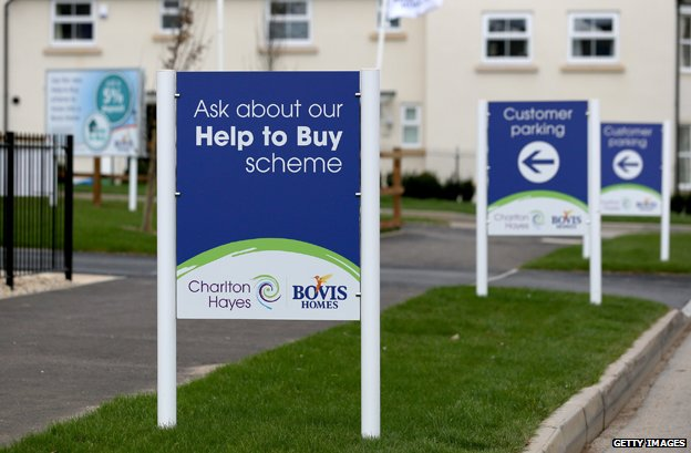"Signs outside newly built homes read ""Ask about our Help To Buy scheme"""