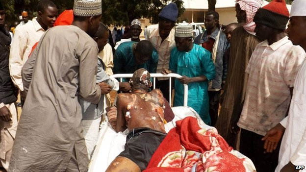 A man injured in a suicide blast is transported on a bed at the General Hospital in northeast Nigerian town of Potiskum on 12 January 2015