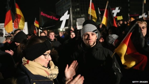DRESDEN, GERMANY - JANUARY 12: Supporters of the Pegida movement march to show their solidarity with the victims of the recent Paris terror attacks during their weekly march on January 12, 2015 in Dresden, Germany