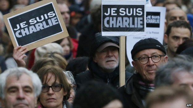 "People hold signs reading ""Je suis Charlie"" during a unity rally in Paris. Photo: 11 January 2015"
