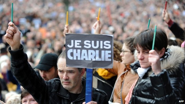 "People hold signs ""I am Charlie"" and pencils during a rally in Brest, western France. Photo: 11 January 2015"