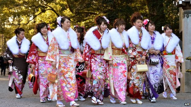 Japanese women dressed in kimonos for their coming-of-age ceremony