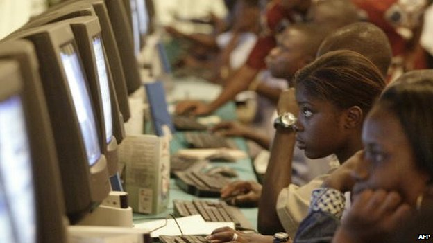 Young Ivorian learn how to use a computer on 22 April 2004 in Abidjan