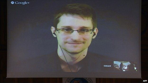 US National Security Agency (NSA) whistleblower Edward Snowden speaks via live video call during the Right Livelihood prize ceremony at the parliament in Stockholm, on December 1, 2014