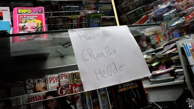 "A note that reads: ""No more Charlie Hebdo"" is posted after all copies of the satirical newspaper were sold out at a newsstand in Paris, 14 January 2015"