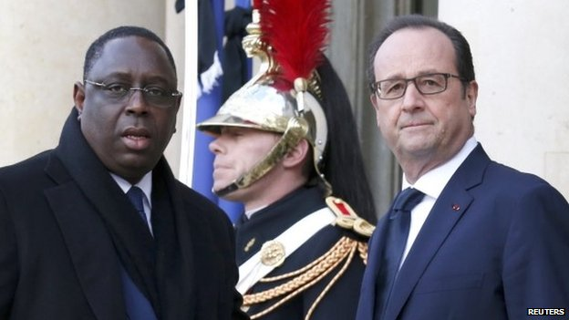 French President Francois Hollande (R) welcomes President of Senegal Macky Sall (L) at the Elysee Palace before a solidarity march in Paris on 11  January 2015