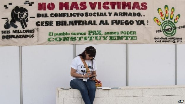 A woman is pictured during the National Forum for Victims on August 4, 2014, in Cali.