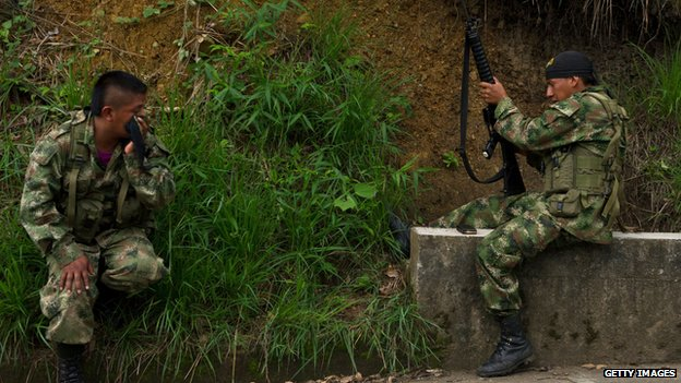 A Farc guerrilla loads his weapon in the rural area of Caloto, department of Cauca, Colombia, on June 4, 2013