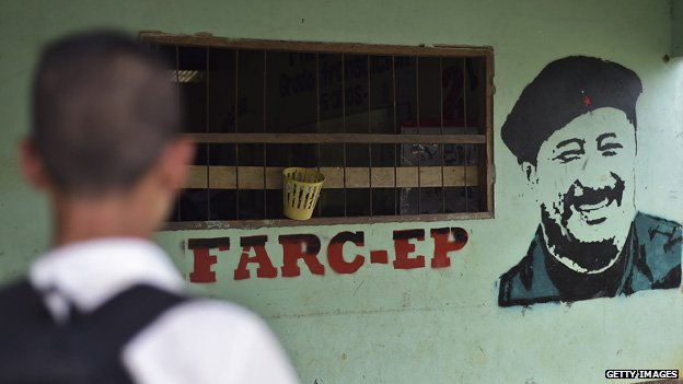 The image of late Farc commander Mono Jojoy can be seen painted on a wall of the school of Puerto Amor on 3 November, 2014.