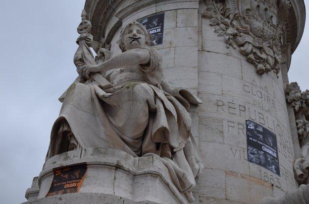 "A statue on Place de la Republique, Paris, symbolically ""gagged"" by protesters, 10 January 2015"