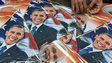 An Indian shopkeeper strings kites with images of Indian prime minister Narendra Modi (C) and US President Barack Obama (L and R) in Mumbai on January 7, 2015.