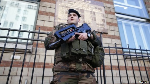 A French soldier secures the access to a Jewish school in Paris, 14 January 2015