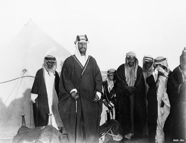 Ibn Saud standing in front of his son and followers near Thaj 1911