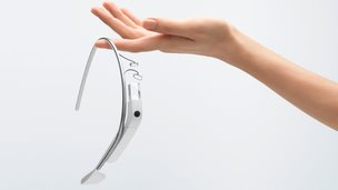 Google Glass held in a hand