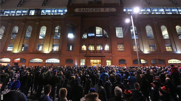 Fans outside the main door at Ibrox