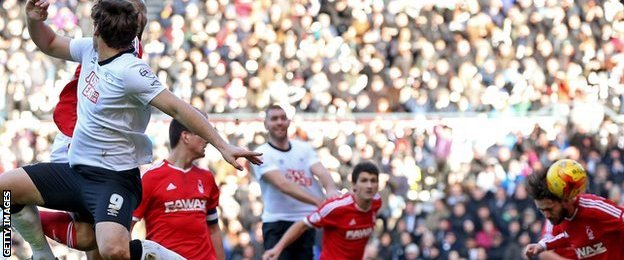 Nottingham Forest's Henri Lansbury heads in to his own goal to give Derby County the lead