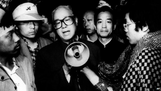 In this May 19, 1989 file photo, Communist Party General Secretary Zhao Ziyang, centre with loud hailer, speaks with fasting university students in Beijing's Tiananmen Square, the last time he was seen in public, early Friday May 19, 1989