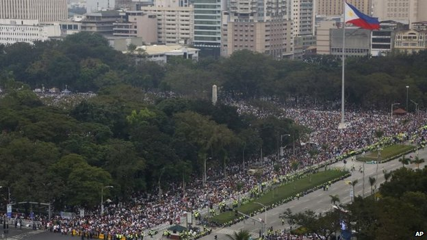 Thousands of people fill the Rizal Park area where Pope Francis is to celebrate Mass to an estimated six million in Manila.