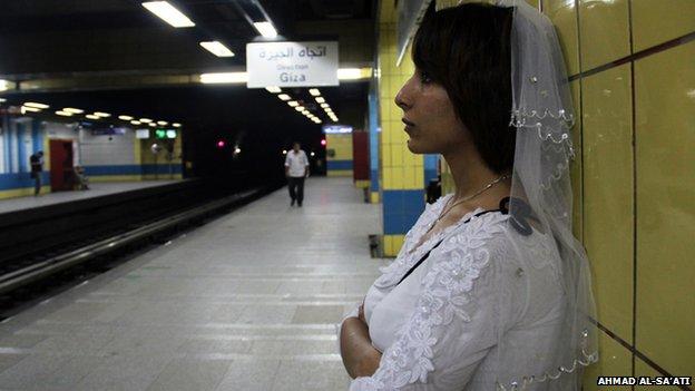 Samah Hamdi in her wedding dress in a metro station