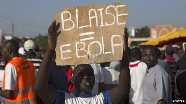 A protester holds a sign, which refers to President Blaise Compaore, during a demonstration in Ouagadougou, Burkina Faso (October 2014)