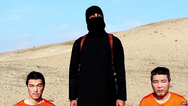 A still of the video appears to show a militant with two hostages