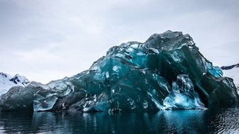 a photograph of an upside down iceberg.