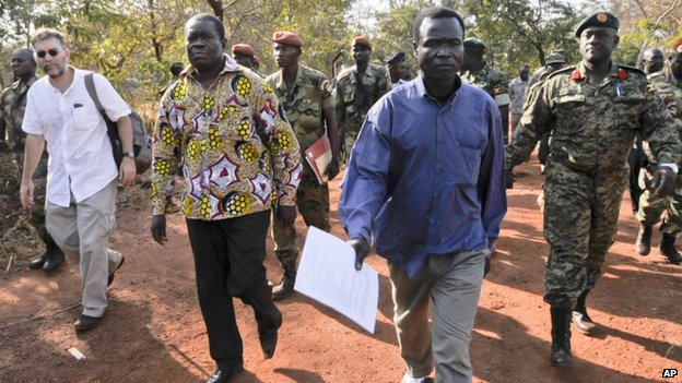 Dominic Ongwen (centre right) in the Central African Republic accompanied by Ugandan Contingent Commander to the African Union Regional Task Force Col Michael Kabango (right) Charge d'Affaires of the US Embassy in Bangui David Brown (left) and other unidentified military officials
