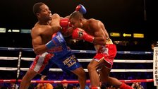 Kell Brook (right) landing a right hook on Shawn Porter in the IBF welterweight title