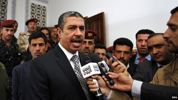 Yemen's newly-appointed Prime Minister Khaled Bahah (C) speaks to reporters after the Yemeni parliament voted to support the new government, in Sana'a, Yemen, 18 December 2014