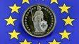 Swiss franc coin and EU flag