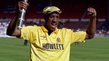 Dion Dublin celebrating promotion with Cambridge United
