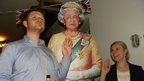 A cardboard cut-out of the Queen, alongside John Heaven and Nora Heaven in Hamburg.