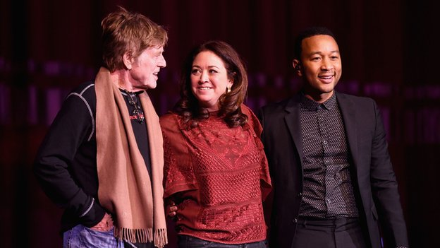 John Legend (right) with Robert Redford and director Liz Garbus