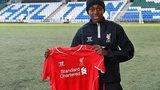 Asisat Oshoala holds up LFC shirt