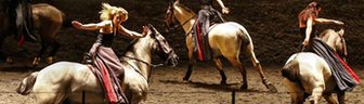 Horses and riders perform on stage during a dress rehearsal of Mozart's Davide penitente in Salzburg