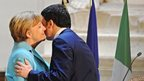Italian Prime Minister Matteo Renzi says goodbye to German Chancellor Angela Merkel