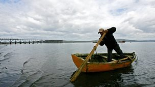 Man in a rowing boat, Chiloe