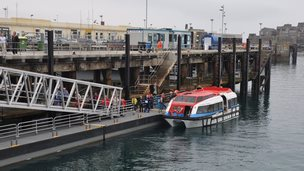 Cruise ship tender discharging passengers at the inter-island quay in Guernsey's St Peter Port Harbour